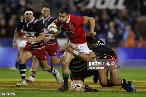 Rhys Webb of the British Irish Lions is hauled down short of the tryline during the 2017 British Irish Lions tour match between the New Zealand...