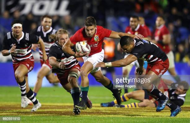 Rhys Webb of the British Irish Lions makes a break during the 2017 British Irish Lions tour match between the New Zealand Provincial Barbarians and...