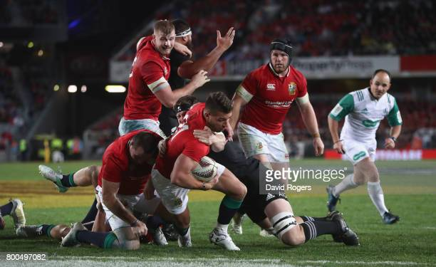 Rhys Webb of the Lions breaks clear to score a late consolation try during the Test match between the New Zealand All Blacks and the British Irish...