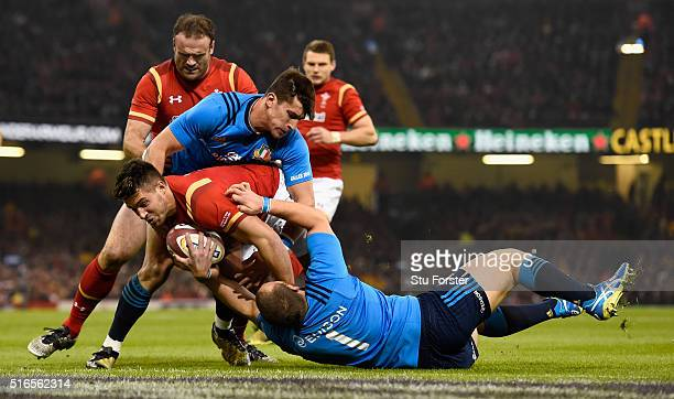 Rhys Webb of Wales crashes through to score the first try during the RBS Six Nations match between Wales and Italy at the Principality Stadium on...