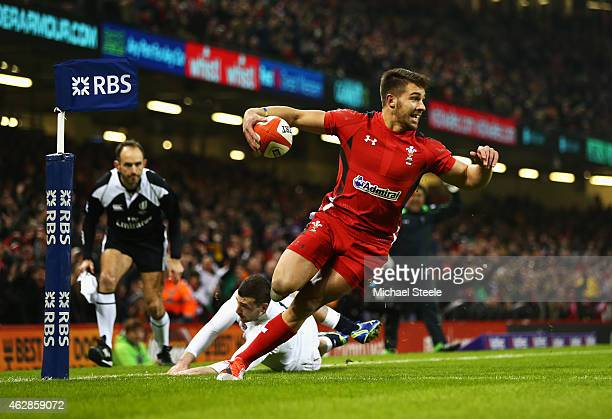Rhys Webb of Wales goes over to score the opening try during the RBS Six Nations match between Wales and England at the Millennium Stadium on...