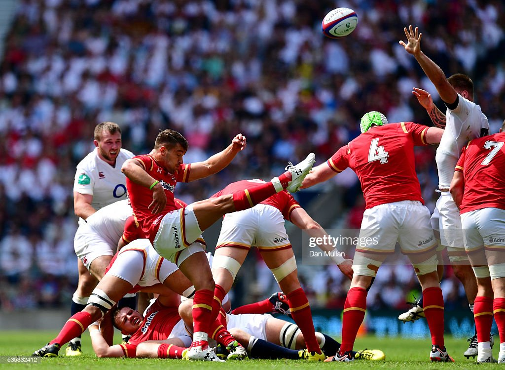 <a gi-track='captionPersonalityLinkClicked' href=/galleries/search?phrase=Rhys+Webb+-+Rugby+Player&family=editorial&specificpeople=8778685 ng-click='$event.stopPropagation()'>Rhys Webb</a> of Wales puts in a box kick during the Old Mutual Wealth Cup match between England and Wales at Twickenham Stadium on May 29, 2016 in London, England.
