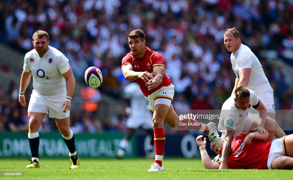 <a gi-track='captionPersonalityLinkClicked' href=/galleries/search?phrase=Rhys+Webb+-+Rugby+Player&family=editorial&specificpeople=8778685 ng-click='$event.stopPropagation()'>Rhys Webb</a> of Wales releases a pass during the Old Mutual Wealth Cup match between England and Wales at Twickenham Stadium on May 29, 2016 in London, England.