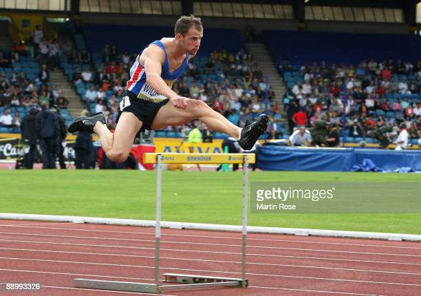 Rhys Williams competes during the men's 400m hurdles Heat 2 at Alexander Stadium on July 11 2009 in Birmingham England