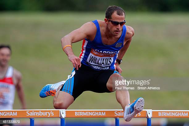 Rhys Williams jumps in the 400m hurdles during day one of the Sainsbury's British Championships at Birmingham Alexander Stadium on June 27 2014 in...
