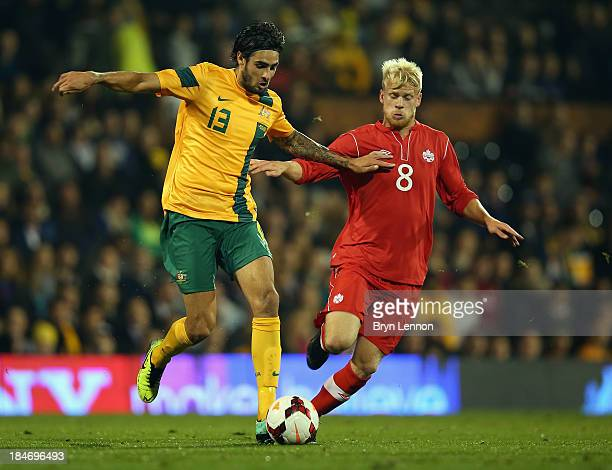 Rhys Williams of Australia battles with Kyle Bekker of Canada during the International Friendly between Canada and Australia at Craven Cottage on...