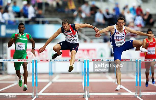 Rhys Williams of Great Britain and Adrien Clemenceau of France compete in the Men's 400 Metres Hurdles Semi Finals during day two of the 21st...