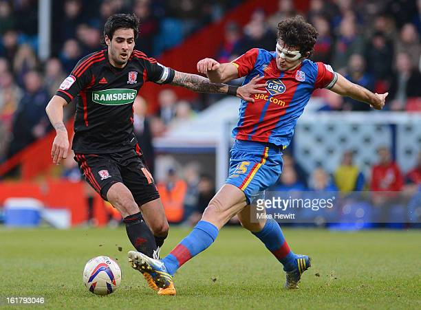 Rhys Williams of Middlesbrough is challenged by Mile Jedinak of Crystal Palace during the npower Championship match between Crystal Palace and...