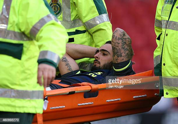 Rhys Williams of Middlesbrough leaves the pitch on a stretcher after suffering an injury during the FA Cup Third Round match between Barnsley and...