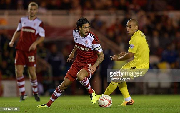Rhys Williams of Middlesbrough looks to get past James Vaughan of Huddersfield during the Sky Bet Championship match between Middlesbrough and...