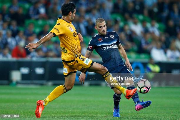 Rhys Williams of the Glory and James Troisi of the Victory contest the ball during the round 23 ALeague match between Melbourne City FC and Perth...