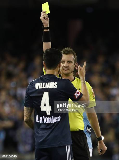 Rhys Williams of the Victory is shown the yellow card by referee Peter Green during the round two ALeague match between Melbourne Victory and...