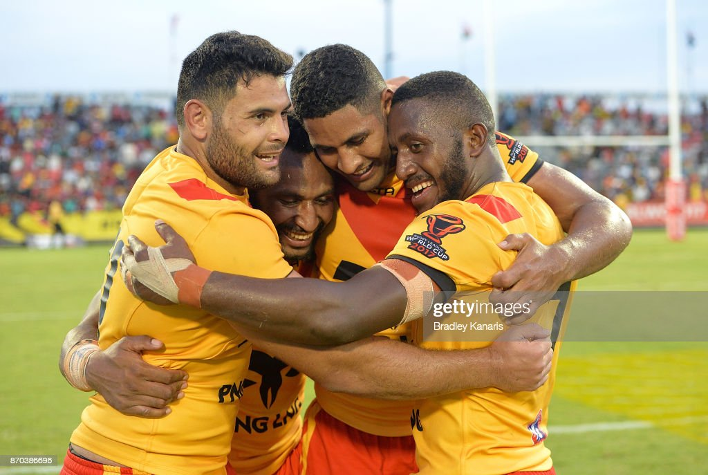 Rhyse Martin, Justin Olam, Nene McDonald and Watson Boas of Papua New Guinea celebrate victory after the 2017 Rugby League World Cup match between Papua New Guinea Kumuls and Ireland on November 5, 2017 in Port Moresby, Papua New Guinea.