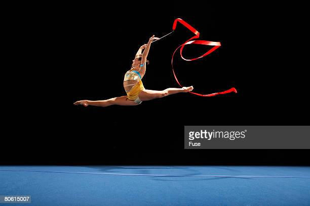 Rhythmic Gymnast Jumping with Ribbon