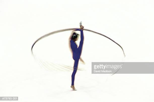 Rhythmic gymnast performing with ribbon, elevated view (Enhancement)