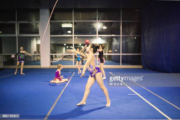 Rhythmic gymnastics groups practising together
