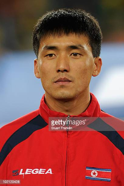 Ri KwangChon of North Korea lines up for the national anthems prior to the 2010 FIFA World Cup South Africa Group G match between Brazil and North...