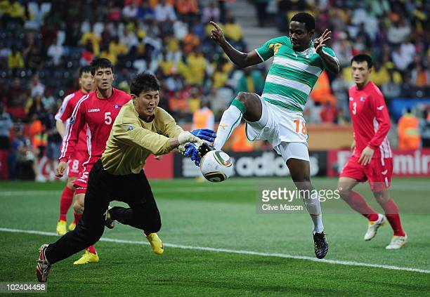 Ri MyongGuk of North Korea and Abdul Kader Keita of the Ivory Coast battle for the ball during the 2010 FIFA World Cup South Africa Group G match...