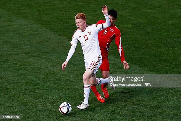 Ri Un Chol of Korea DPR and Zsolt Kalmar of Hungary battle for the ball during the FIFA U20 World Cup New Zealand 2015 Group E match between Korea...