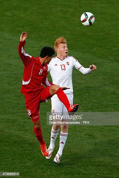 Ri Un Chol of Korea DPR and Zsolt Kalmar#13 of Hungary battle for the ball during the FIFA U20 World Cup New Zealand 2015 Group E match between Korea...