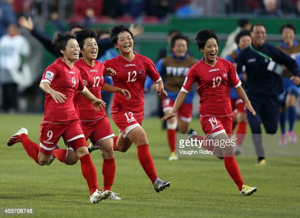 Ri Un Sim Choe Un Hwa Jon So Yon and Ri Kyong Hyang of Korea DPR celebrate victory in the shoot out during the FIFA U20 Women's World Cup Canada 2014...