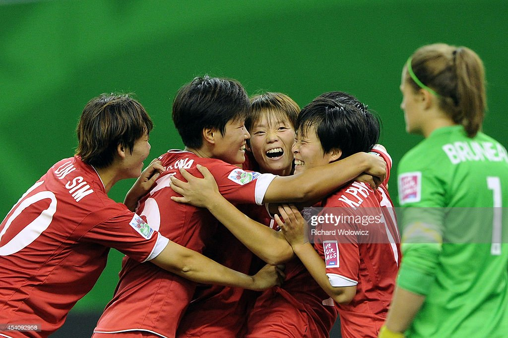Ri Un Yong of Korea DPR celebrates her second half goal with teammates during the FIFA Women's U-20 3rd place game against France at Olympic Stadium on August 24, 2014 in Montreal, Quebec, Canada. France defeated Korea DPR