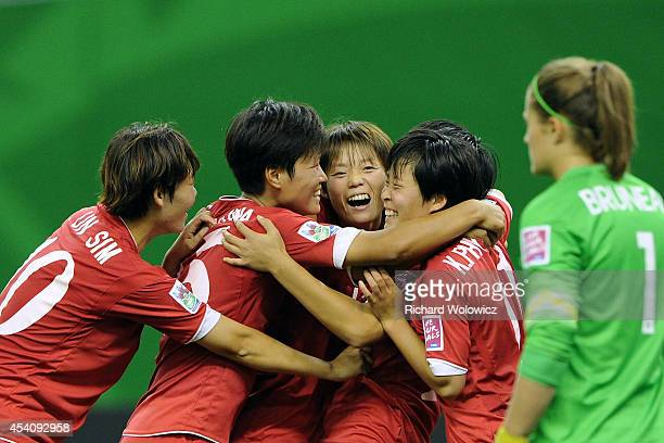 Ri Un Yong of Korea DPR celebrates her second half goal with teammates during the FIFA Women's U20 3rd place game against France at Olympic Stadium...