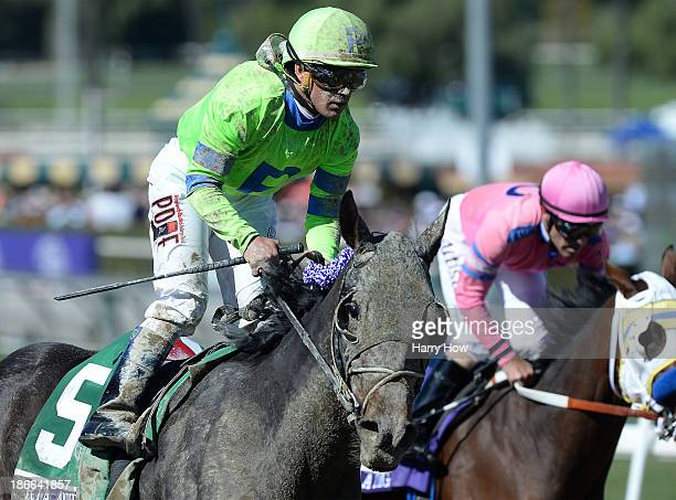 Ria Antonia ridden by Javier Castellano reacts after crossing the finish line while She's a Tiger ridden by Gary Stevens follows in the Juvenile...