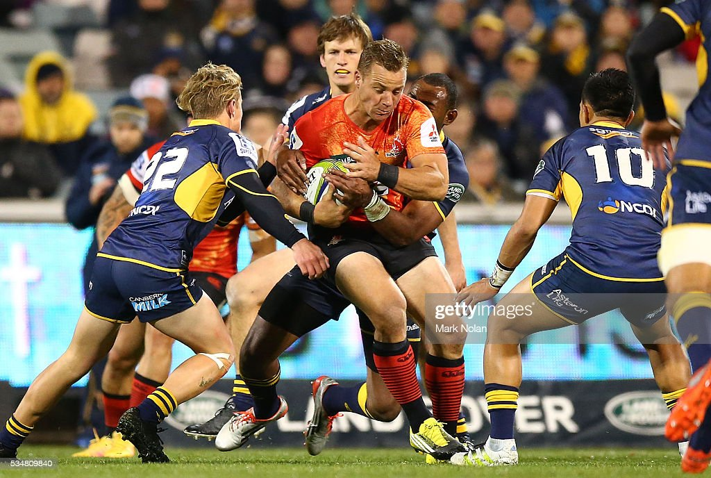 <a gi-track='captionPersonalityLinkClicked' href=/galleries/search?phrase=Riaan+Viljoen&family=editorial&specificpeople=4360788 ng-click='$event.stopPropagation()'>Riaan Viljoen</a> of the Sunwolves is tackled during the round 14 Super Rugby match between the Brumbies and the Sunwolves at GIO Stadium on May 28, 2016 in Canberra, Australia.