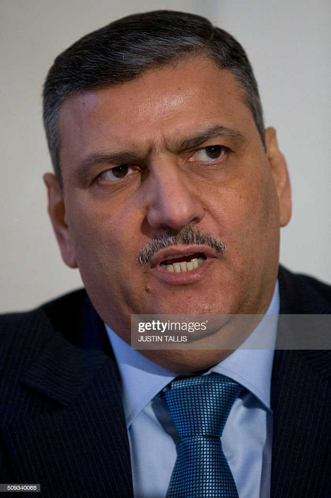 Riad Hijab, chief coordinator of the Syrian opposition High Negotiations Committee (HNC), speaks during a press conference in London on February 10, 2016. Sieges on towns and cities across Syria must be lifted and air strikes on civilian areas must stop if the opposition is to resume talks in Geneva as planned on February 25, Riad Hijab said on February 10. TALLIS