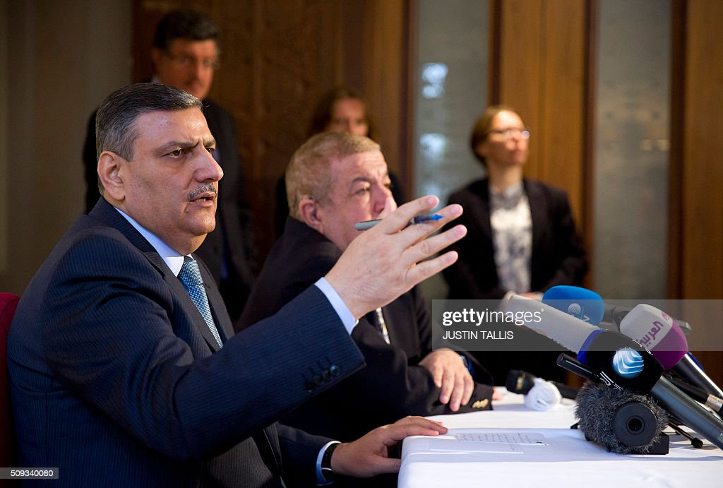 Riad Hijab (L), chief coordinator of the Syrian opposition High Negotiations Committee (HNC), speaks during a press conference in London on February 10, 2016. Sieges on towns and cities across Syria must be lifted and air strikes on civilian areas must stop if the opposition is to resume talks in Geneva as planned on February 25, Riad Hijab said on February 10. TALLIS