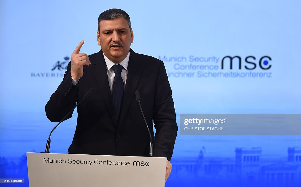 Riad Hijab, head of the High Negotiation Committee that represents several Syrian opposition groups, speaks during a panel discussion on the third day of the 52nd Munich Security Conference (MSC) in Munich, southern Germany, on February 14, 2016. / AFP / Christof STACHE