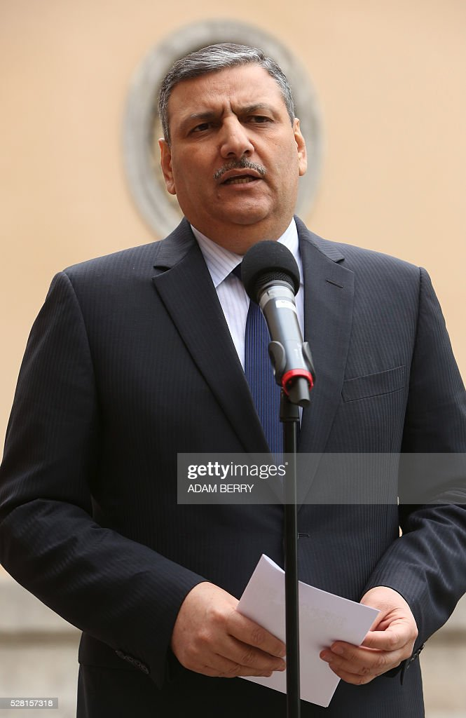 Riad Hijab, head of the Syrian High Negotiation Committee (HNC) gives a statement to the press at the foreign ministry's guest house Villa Borsig in the suburbs of Berlin on May 4, 2016 ahead of a meeting on Syria as concerns grow over the war-torn country's faltering truce. / AFP / Adam BERRY