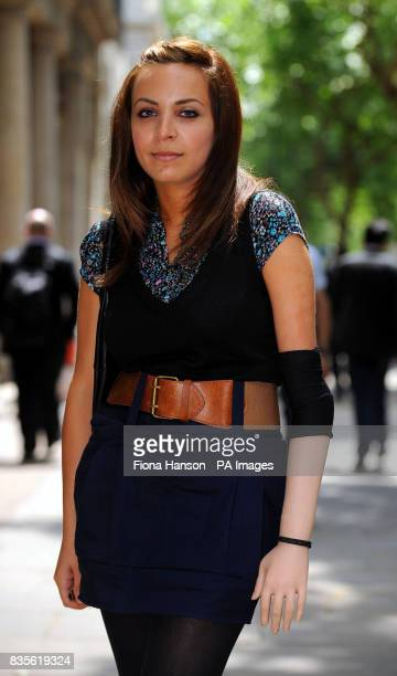Riam Dean who wears a prosthetic arm outside an employment tribunal in London for the first day of her case against American retailer Abercrombie...