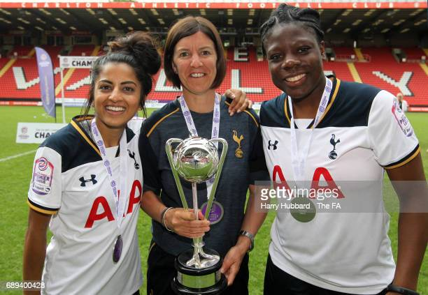 Rianna Soobadoo Karen Hills manager and Eartha Pond of Tottenham with the trophy after the FA Women's Premier League Playoff Final between Tottenham...