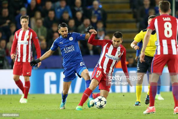 Riayd Mahrez of Leicester City in action with Angel Correa of Atletico Madrid during the UEFA Champions League Quarter Final Second Leg match between...