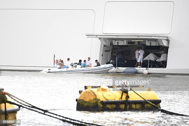 A rib carries people from Russian billionaire Andrey Melnichenko's £225m Philippe Starckdesigned boat as it sits moored next to HMS Belfast on the...