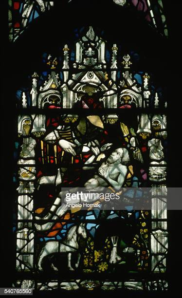 A rib is removed from Adam's side in a depiction of the creation of the world designed by John Thornton as part of the Great East Window in York...