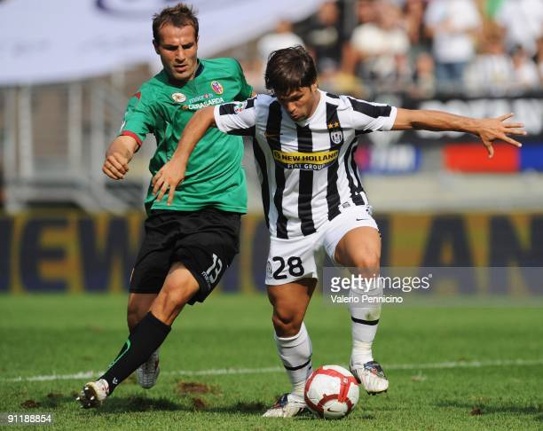 Ribas Da Cunha Diego of Juventus FC is challenged by Daniele Portanova of Bologna FC during the Serie A match between Juventus FC and Bologna FC at...