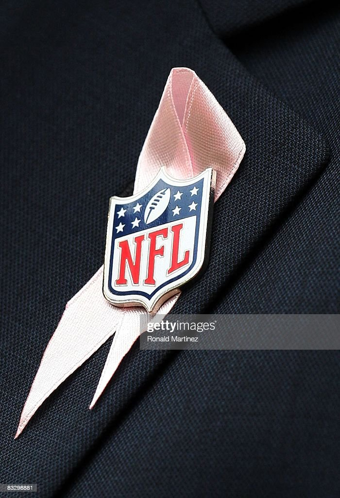 A ribbon and NFL pin in support of Breast Cancer Awareness month during a game between the Miami Dolphins and the Houston Texans at Reliant Stadium on October 12, 2008 in Houston, Texas.