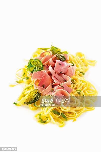 Ribbon noodles with ham, basil and truffles