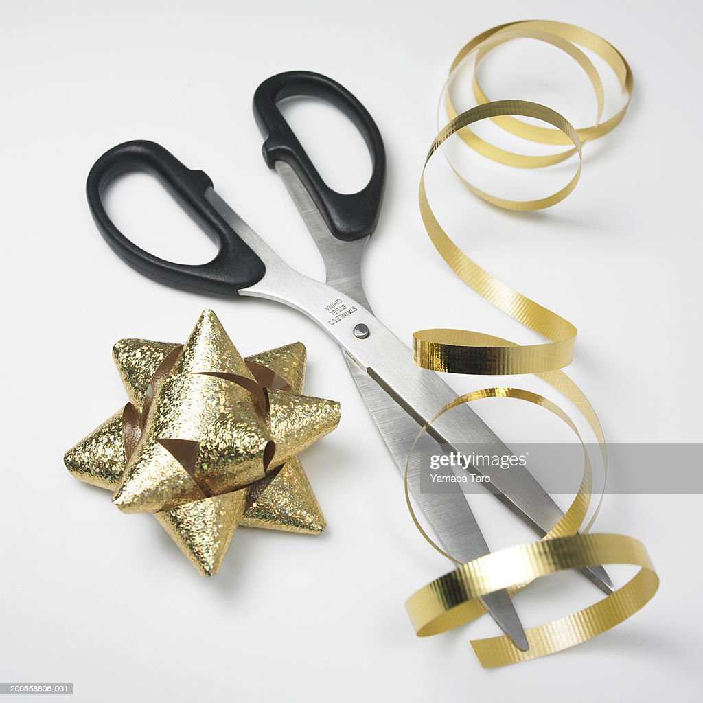 Ribbon with scissor, close-up : Stock Photo