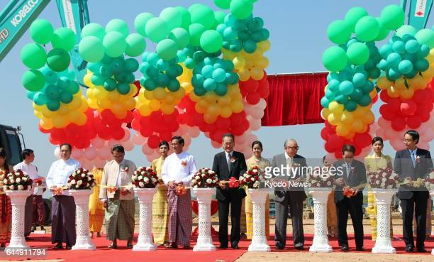 A ribboncutting ceremony is held to mark the beginning of construction to expand the Japanesebacked Thilawa special economic zone near Myanmar's...
