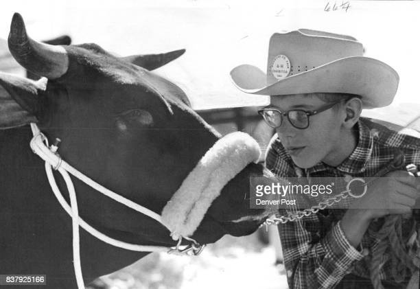 SEP 9 1960 SEP 11 1960 ribbons his entrants won in the 4H sheep show Above Richard Walker talks to his Santa Gertrudis heifer that won a reserve...