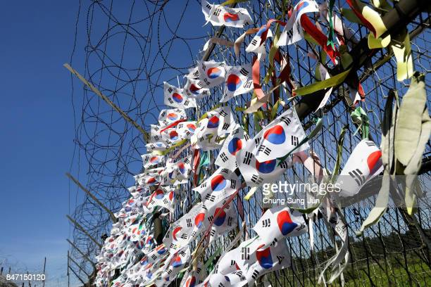 Ribbons wishing for reunification of the two Koreas on the wire fence at the Imjingak Pavilion near the demilitarized zone of Panmunjom on September...
