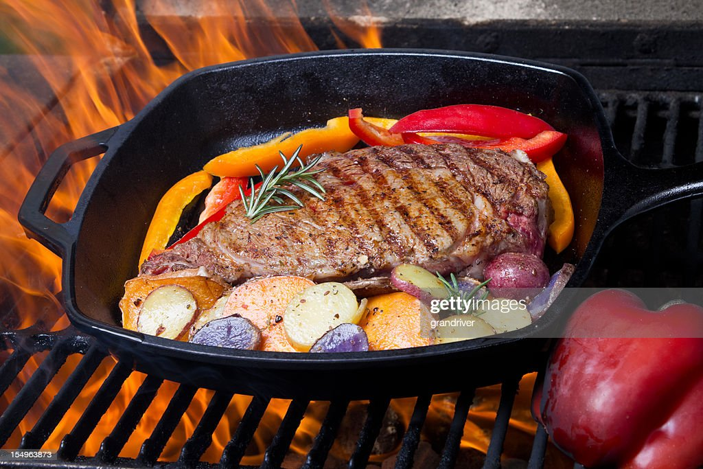 Ribeye Steak Roasted Potatoes And Peppers On Grill Stock Photo | Getty ...