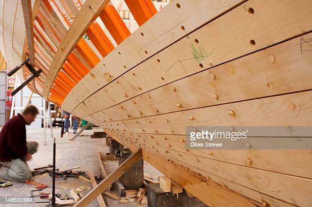 Ribs and planks of??Huon pine on wooden boat being built in the Huon Valley.