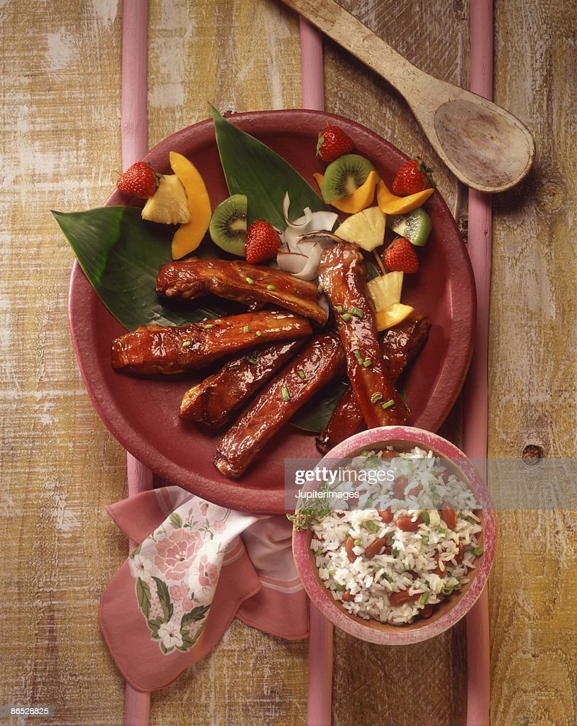 BBQ ribs with fruit kabobs and rice : Stock Photo