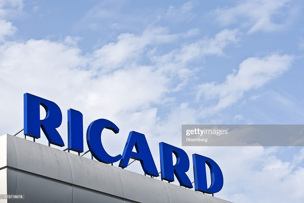 A Ricard logo sits above the bottling plant of wine and spirits producer Pernod Ricard SA in Bordeaux, France, on Tuesday, July 16, 2013. Distillers such as Diageo and Pernod Ricard SA are seeking to expand in emerging markets where booming economic growth is creating a burgeoning middle class with more disposable income. Photographer: Balint Porneczi/Bloomberg via Getty Images