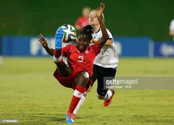 Ricarda Walkling of Germany and Easther Mayi Kith of Canada battle for the ball during the FIFA U17 Women's World Cup 2014 group B match between...